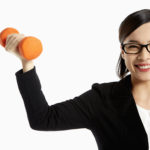 happy business woman lifting weights