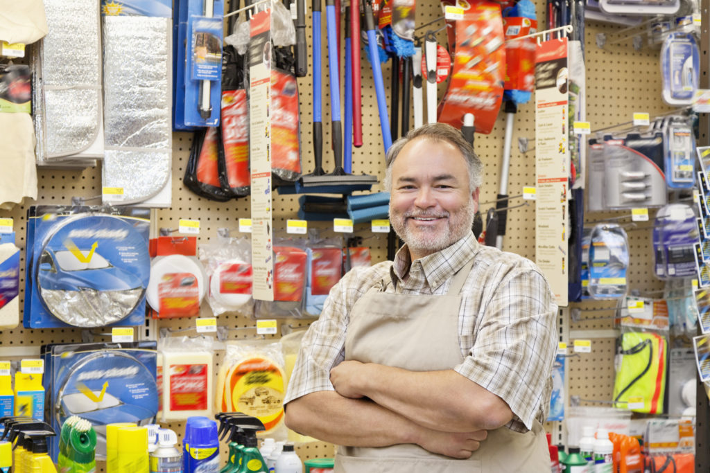 A happy man working in a shop