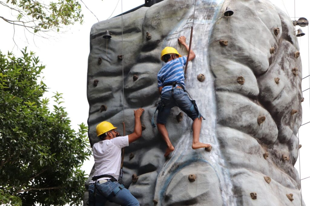 Enjoy fun outdoor team-building activities like rock climbing with your staff
