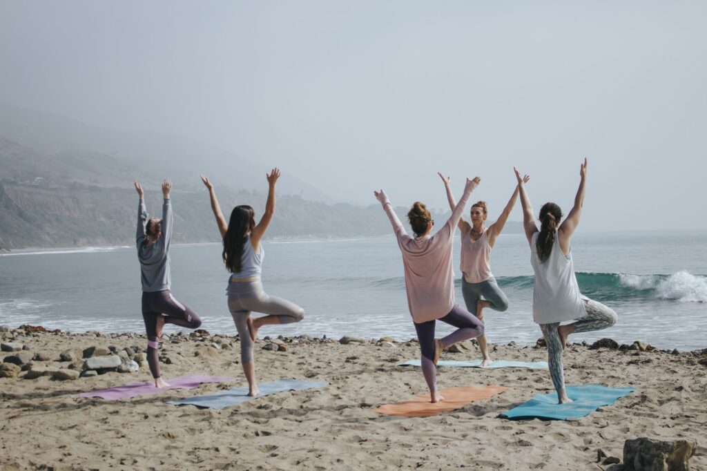 Doing yoga together outside is one of many fun outdoor team-building activities